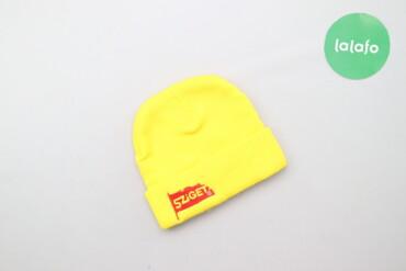 Жіноча жовта шапка з написом Sziget    Напівобхват голови: 19 см Висот