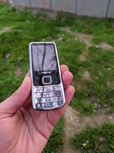 телефон раскладушка флай ezzy trendy в Азербайджан: Nokia 6700 Telefon yaxşı vəziyyətdədir.alınan günnən bizdə olub adaptı