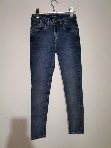 Exact Jeans farmerice. Teksas slican zarinom. Bez ostecenja. Poludubok