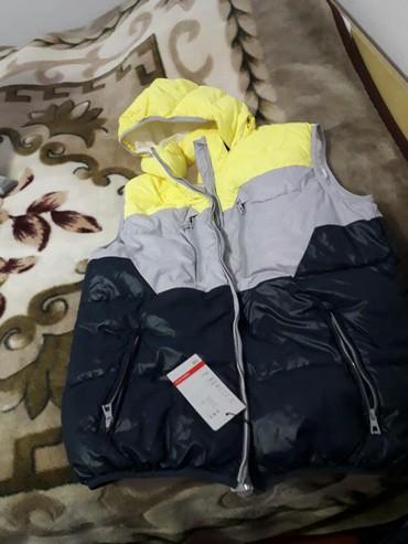 купить женскую обувь недорого в Кыргызстан: Продаю женскую болоньевую жилетку,совершенно новая!