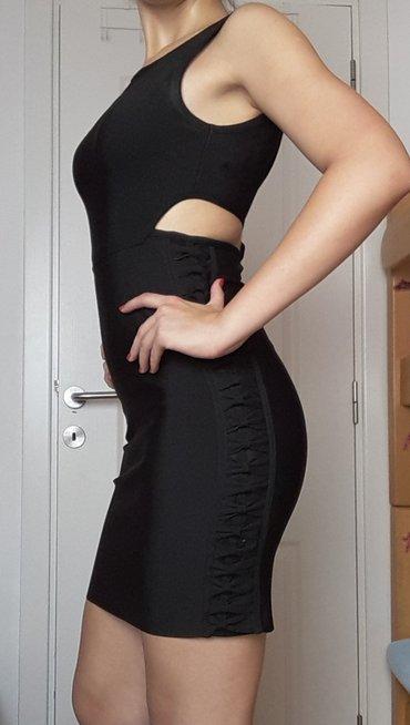 Herve leger crna haljina sa prorezima. Odgovara svim tipovima gradje,  - Borca