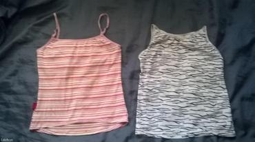 Dve vrlo lepe i prijatne majice. Roze tcm vel. 38,ima donji deo do - Prokuplje