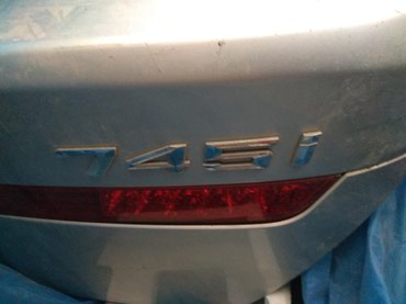задняя фара в багажник ниссан примера р11 в Азербайджан: BMW Yük yerinin qapağı .BMW 745 E65/E/66 . Yuk yerinin qapağı