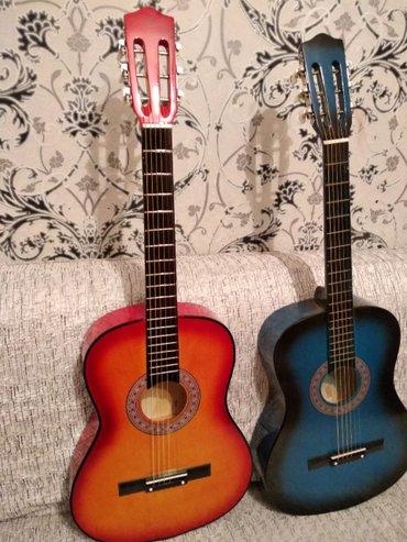 Bakı şəhərində Ekvalazerli ve ekvalazersiz gitaralarin satisi