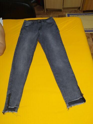 Pink jeans farmerke - Srbija: Zenske crne uske farmerke. Imaju podesivi rajfeslus na krajevima, oko
