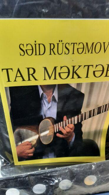 Tar mektebi Seyid Rustemov  Rast musiqi aletleri maģaza ùnvanalari   1