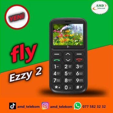 Fly - Azərbaycan: Yaşlılar üçün iri düyməli (knopkalı) telefon.Çox gözəl dizayna malik