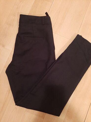 Teget,elegantne pantalone,duboki struk. extra stoje. vel 36
