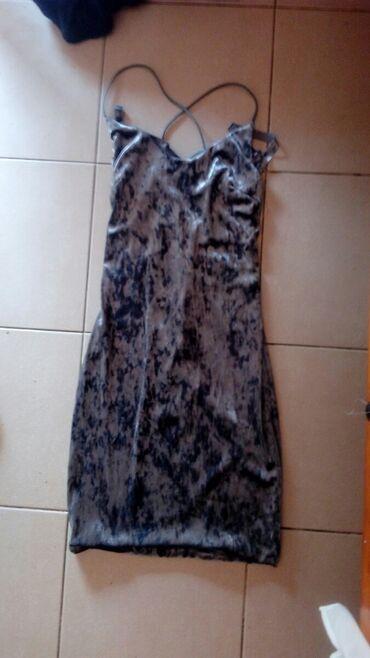 Γκρι φόρεμα μέγεθος S,έχει φορεθεί μία φορα