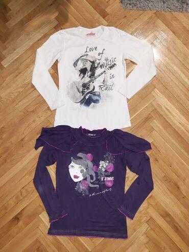 Dve majice vel. 10.U dobrom stanju.Obe za 500.ili pojedinacno