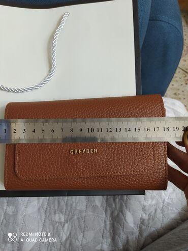 Продаю новый кожаный кошелек. без торга.смотреть все фото