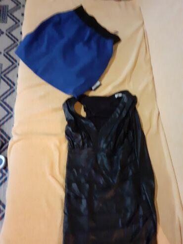 Kozna haljina i kozna jakna velicina l suknja je od somota ista