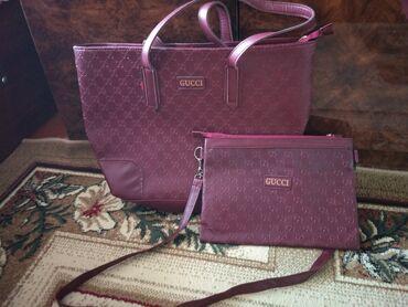 Bordo rəngli dəst çanta satılır. Sumka + klatç. Yenidir. Qiyməti 18 m
