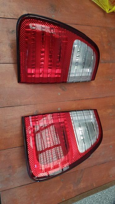 Задние фонари на дверь багажника Lexus LX 470 (2003-2005) в Бишкек