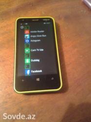 Bakı şəhərində İki ilin telefonudur. Açıq yaşıl rəngli, sarı haşiyəs var. Xarici