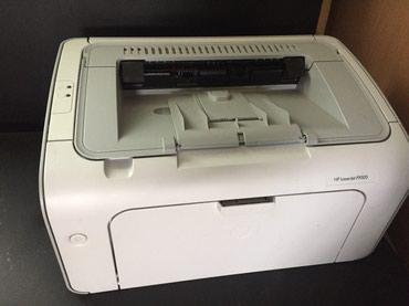Продаю принтел HP P1005 в идеальном состоянии с новым картреджем . в Бишкек