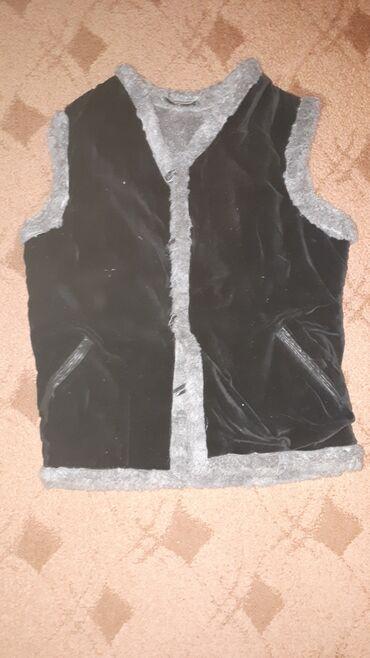 серая kia в Ак-Джол: Безрукавки меховые . С кармашками