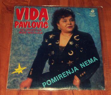 Fly iq4515 evo energy 1 - Srbija: Vida Pavlović (album Pomirenja nema) Godina izdanja: 1991Izdavač