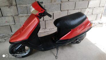 Мотоциклы и мопеды - Кыргызстан: Продаю скутер Хонда такт. 2-х тактный. Объем 0.5 куба.В хорошем