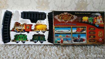 оюнчуктар в Кыргызстан: Продаю детскую игрушку поезд на батарейках состояние отличное