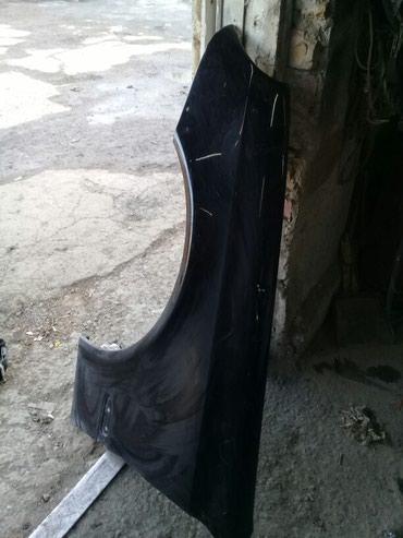 Левое крыло 211 кузов , есть небольшой дифект в Бишкек