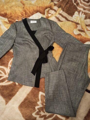 Очень качественный костюм. одевала пару раз. Производство Турция