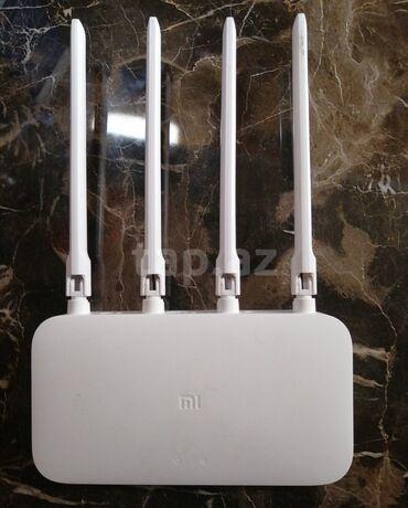 Mi routher1 ay islenmis router model MI 4 antena ela veziyyetdedir35