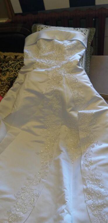 Продаю свадебный платье новая на запах даже. ! одевали всего на