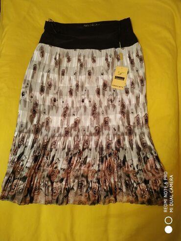 Новая плиссированая юбка
