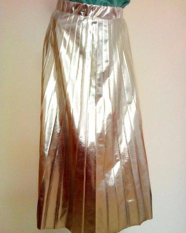 Zenska suknja. Velicina S ali odgovara i drugim velicinama