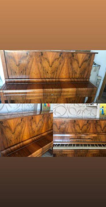 Pianonu 230 manata satılır.Yaxşı vəziyətdedir sadece üst qapaginda bir