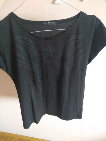 Ski jakne - Srbija: Sisley majica, takodje prosledjena kao poklon. Na njoj se vidi da nije