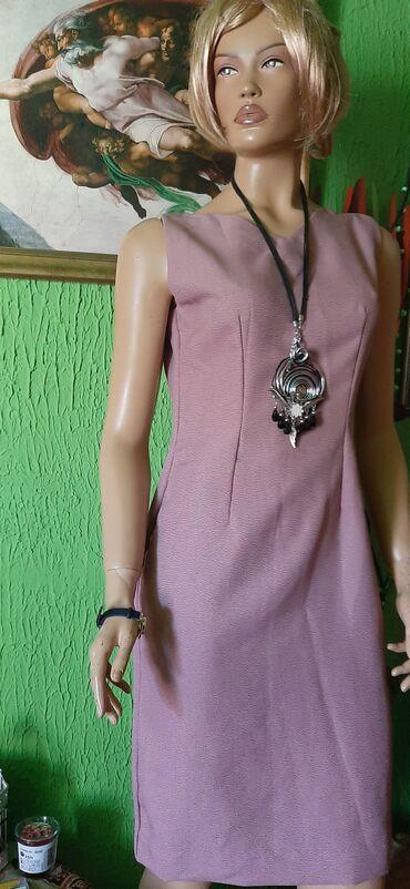 Klasicno poslovna haljina,nezno lila boje,vel 38
