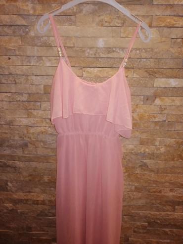 Nova prelepa dugacka haljina, ima postavu ispod. Na brtelama ima 3 - Belgrade