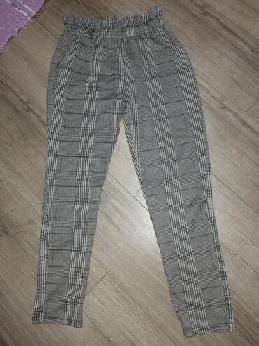 Pantalone, karirane, ocuvane, nema oštećenja, veličina L