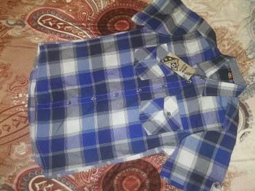 Рубашка новая. Турция.на возраст 12-14 лет.цена 150сом