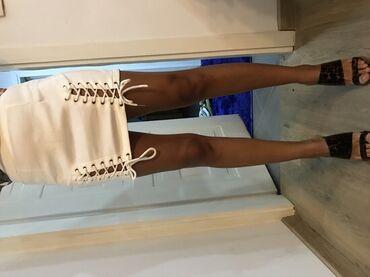 Bela suknja u S velicini