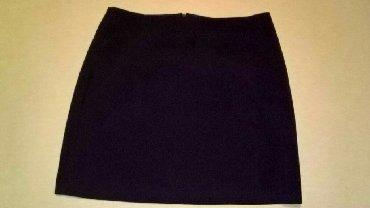 Ženska odeća   Svrljig: Suknja sa šlicem od 8 cm na levoj nozi,poluobim struka 37,dužina