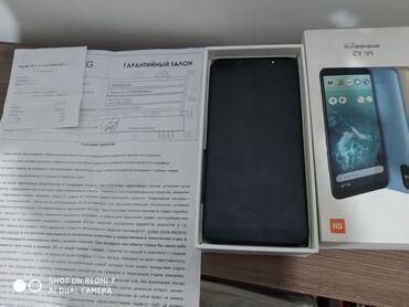 чек в Кыргызстан: Б/у Xiaomi Mi A2 64 ГБ Черный