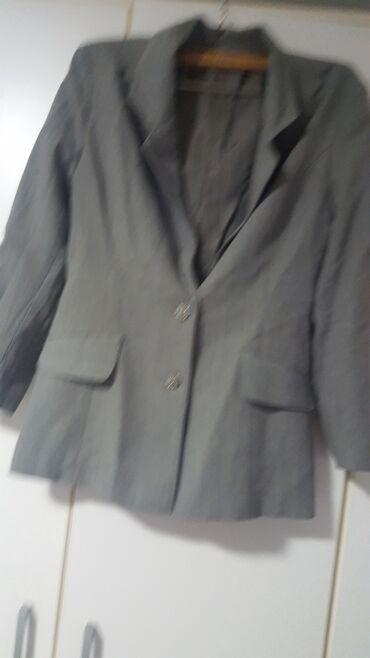Ženski strukirani sako sa džepovima, postavljen. Sive boje