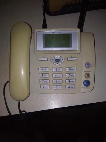 Купить сотовый телефон бу - Кыргызстан: Радиотелефон от Кыргызтелеком- с номером,5000 с