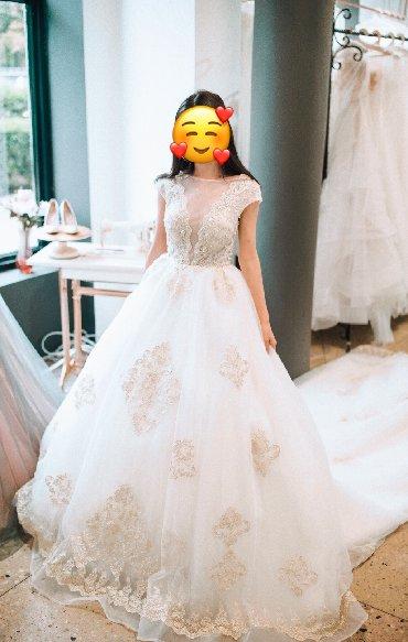 Продаю шикарное свадебное платье со шлейфом(собирается) + подъюбник