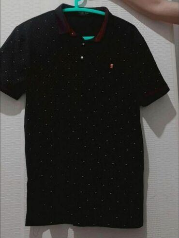 Черная футболка поло, ни разу не носили. Размер xs,s