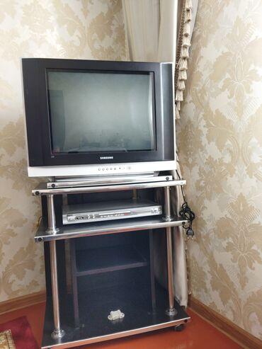 Телевизор в комплекте тумбочка и DVD . Всё вместе . Работает хорошо