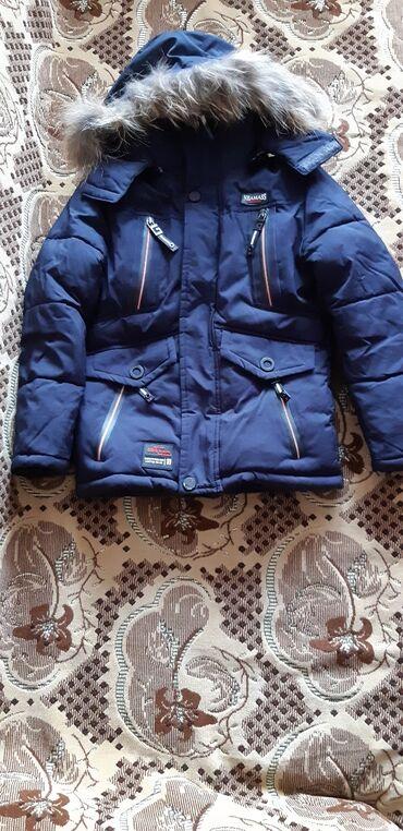 Продаю детскую зимнюю куртку на мальчика 5-6 лет.Размер 104. Состояние