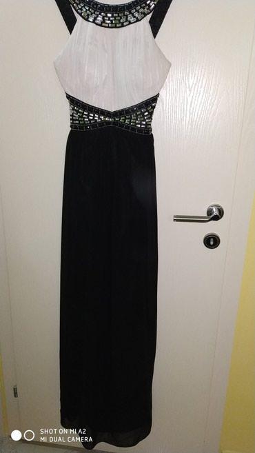 Elegantna haljina duga, po sebi ima cirkone preudobna, broj je 36, - Lazarevac