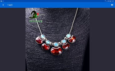 mavi qadın köynəyi - Azərbaycan: BOYUNBAGI (qlrmlzl va mavi kristaldan ibaratdir)15m