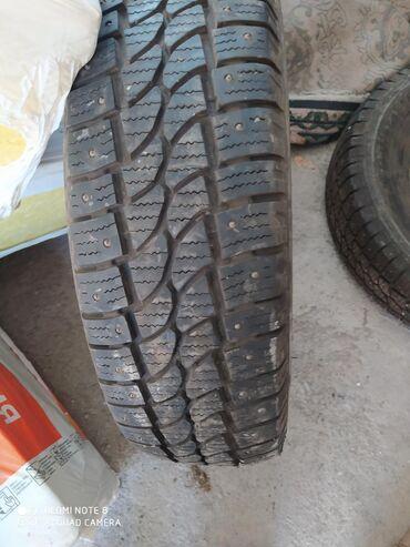 работа с 16 лет в Кыргызстан: Продаю зимние шиповные шины 6 шт размер 225.75 16 с. Сешка . состояние