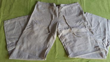 Pantalone uz telo - Srbija: Zenske pantalone tanje vel.L(polovne bez ostecenja)svetlo bez