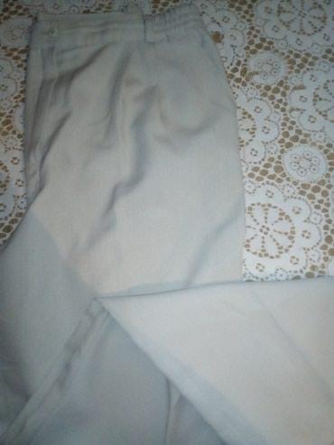 Zenske krem pantalone velicina 46. - Sid